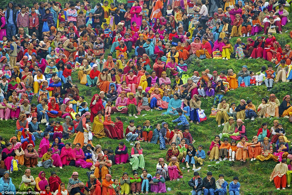 A group of people sit outside in Himachal, north India. Some how, even among all the colours, their individual shades seem to stand out