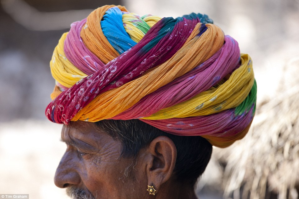 This Indian man wears a traditional Rajasthan turban. As turbans are a Sikh man's personal choice, this man is clearly very colourful