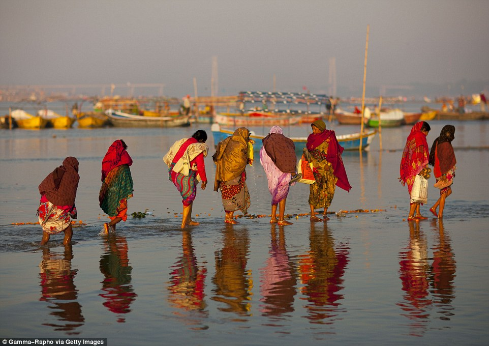 InAllahabad, north India, take a dip in the Ganges while wearing saris. Hindus bathe in the Ganges to cleanse themselves of their sins