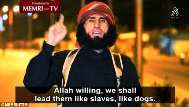 Gesturing with a single finger up to the sky, indicating devotion to Allah, the man says that all of those now carrying out airstrikes against ISIS will be led 'like slaves, like dogs'