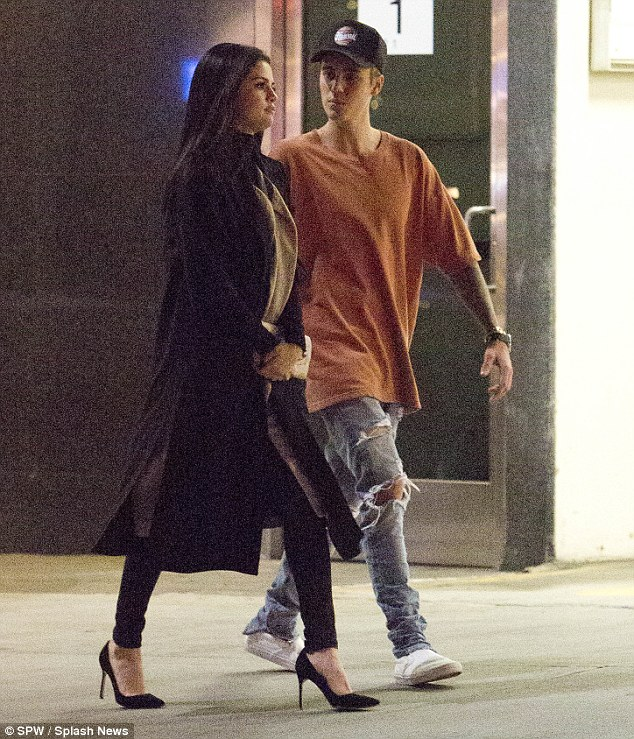 Stepping out: The pair left little distance between them as they spent even more time alone on Friday