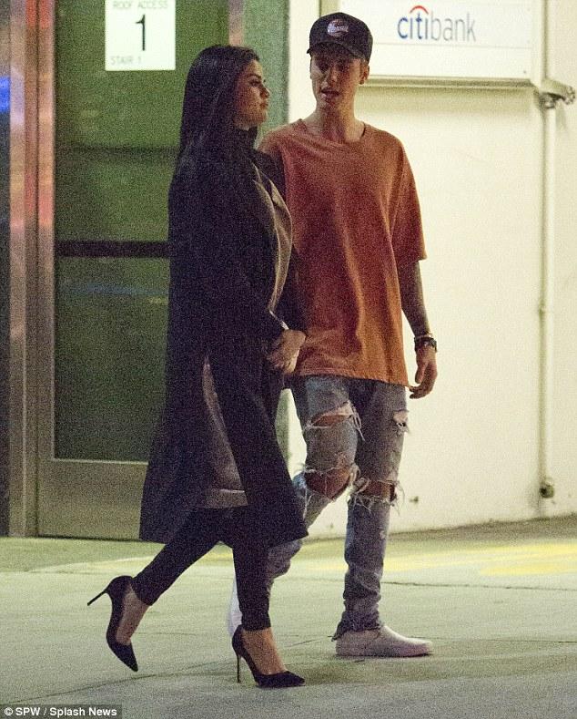 The object of his attention: Justin can't take his eyes off the brunette beauty, who certainly looked glam