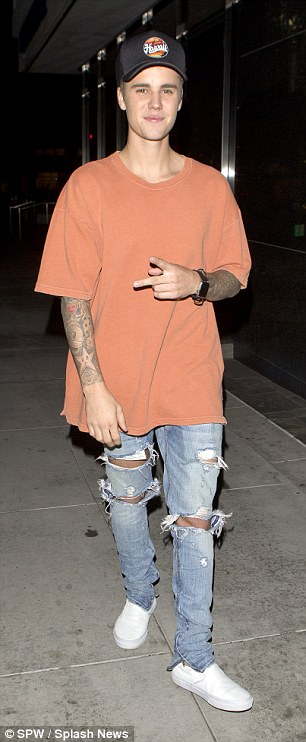 Justin certainly seemed to have a spring in his step as he greeted onlookers