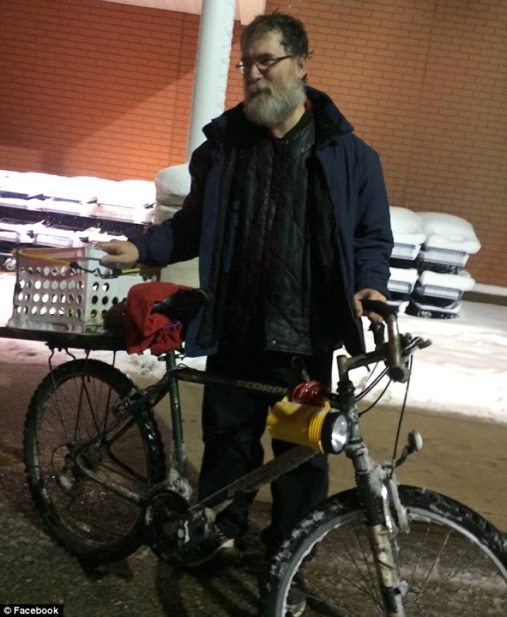 Difficult time: Tony Berard (above) of Waterford, Michigan rides his bike 14 miles every day to and from work to save money for his ill wife and pay for her caretaker