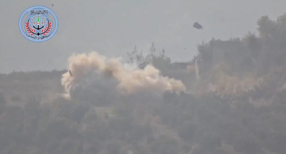 Destruido: Un portavoz rebelde dijo que las tropas dispararon un misil Tao que destruyó el helicóptero después de aterrizar y sus pilotos había abandonado la aeronave
