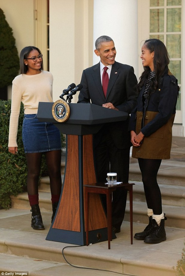 President Obama thanked daughters Sasha (left) and Malia (right) for humoring him again this year by taking part in the turkey pardoning ceremony. 'They do this solely because it makes me feel better,' he said