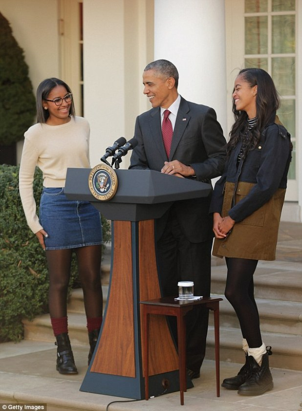 Made you laugh: The president turned to his younger daughter to check she had gone for his laughter line too