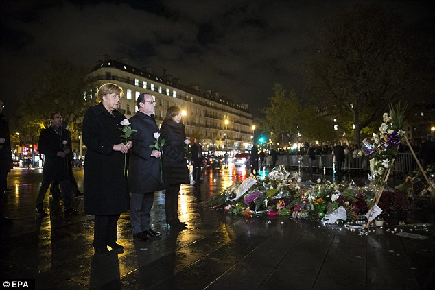 All three officials left a single white rose in memory of the 130 people killed in the terror attacks