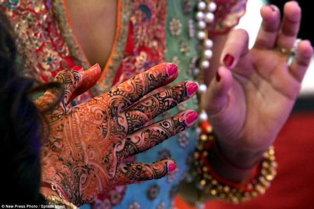 Many of the women at the wedding wore traditional Indian dress and also decorated their hands with traditional henna tattoos