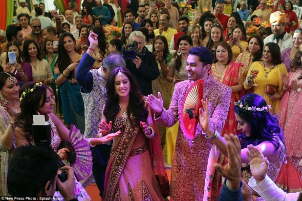 A circle was formed around the newlyweds at the party as everybody clapped while the wedding party entertained with a dance