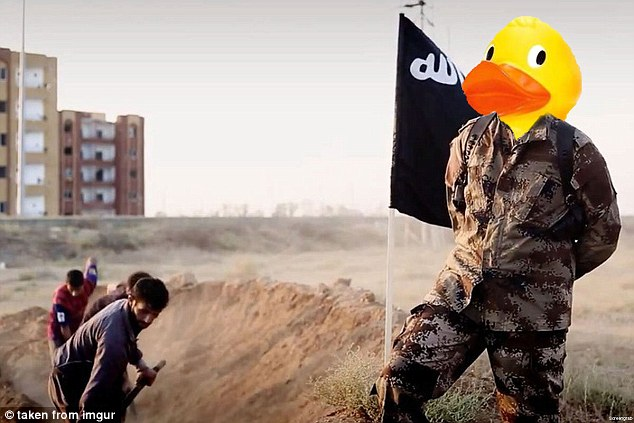 This duck has replaced the image of an ISIS terrorist guarding men digging their own graves