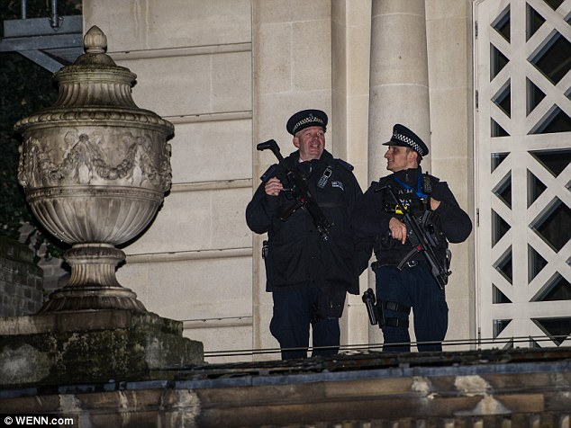 Armedpolice were deployed to the protest on the roof of the Queen's Gallery at Buckingham Palace yesterday