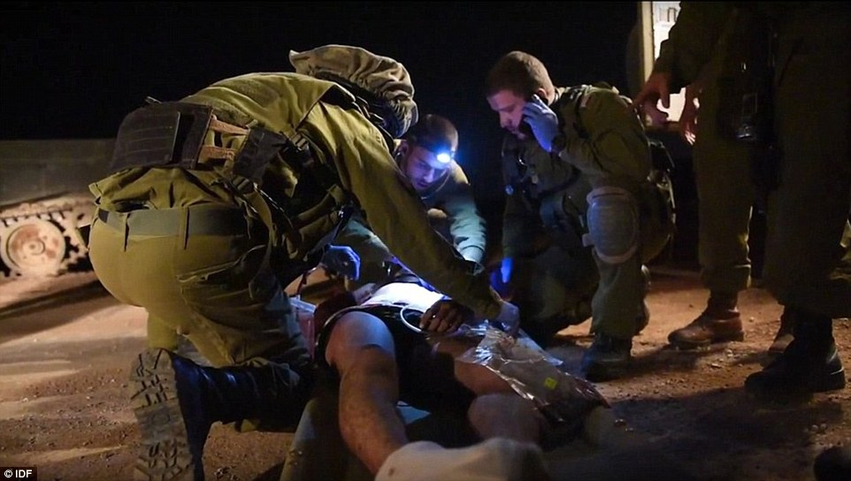 Danger: Israeli commandos are carrying out similar rescues every night - but their government's motive for authorising the extraordinary missions is unclear