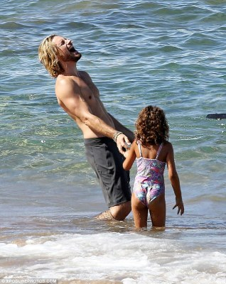 Tickled: The model dad threw back his head and had a belly full of a laugh