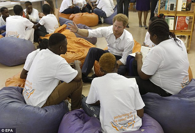 On a visit to Siyabonga Secondary School in Soweto township Harry met students taking part in the Nelson Mandela – The Champion Within programme, which uses the former President and anti-apartheid hero's life to inspire young people in leadership
