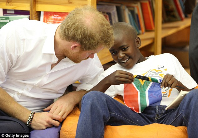 The teenager, who was clutching a South African flag, smiled with delight as he chatted to the visiting royal. Prince said that Harry didn't comment on the similarities in their names, but he added: 'I liked him very much.'