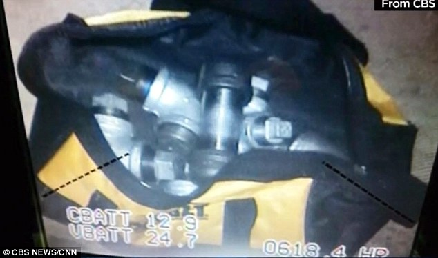 A black and yellow duffel bag stuffed with home-made pipe bombs was recovered from a California home linked to suspects Syed Rizwan Farook and his wife Tashfeen Mali