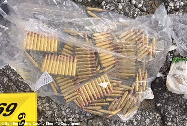 An additional 1,400 rifle rounds were found inside the bullet-riddled vehicle the pair used to evade police on Wednesday. Police also recovered more than 2,000 handgun bullets