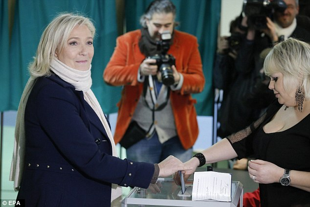 Power: National Front leader leader Marine Le Pen casts her vote at a polling station during the first round of votes on Sunday, in Henin-Beaumont, northern France