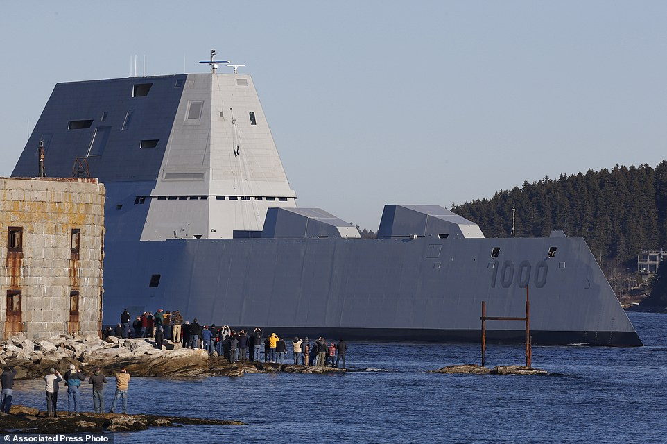 Heading out to sea: The 600-foot-long destroyer cruised along the Kennebec River to the Atlantic on its maiden voyage