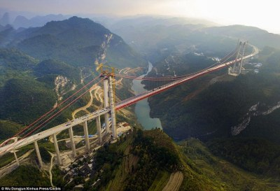 Extreme:The bridge in Guizhou, China, which cost £158million and took two years to build, will be 1,332ft tall and with a span of 3,707ft