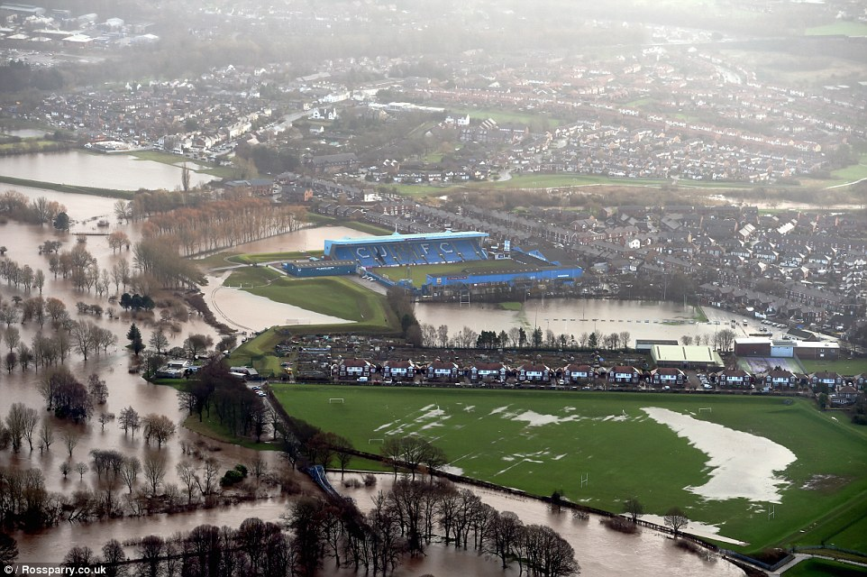 Incredible aerial photographs taken today show the vast extent of the flooding which forced thousands of people out of their homes in Carlisle and left a wake of devastation after Storm Desmond brought record amount of rainfalls including 13.5 inches in just 24 hours