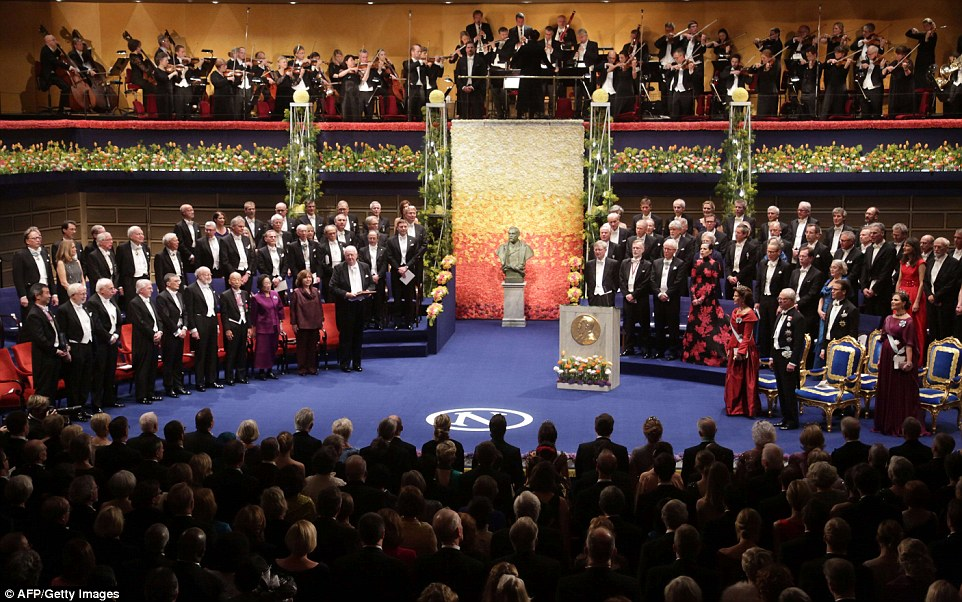 Laureatesand guests are pictured during the ceremony with the hall decked out in fresh flowers as is tradition