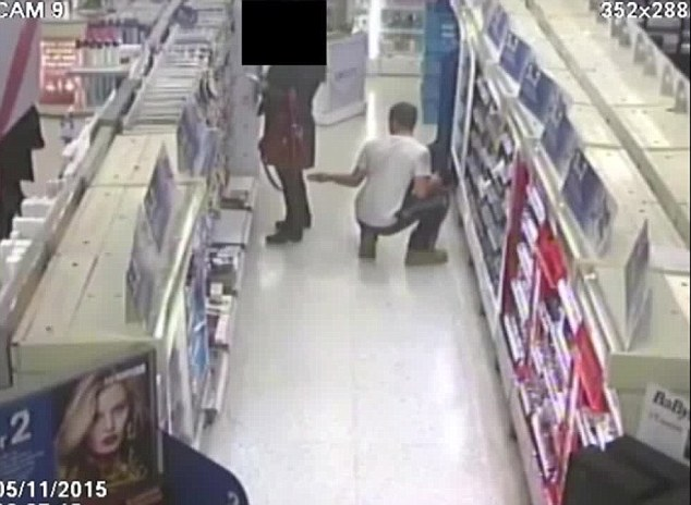 Sneaky: The suspect then apparently took out his phone and positioned it between the woman's legs
