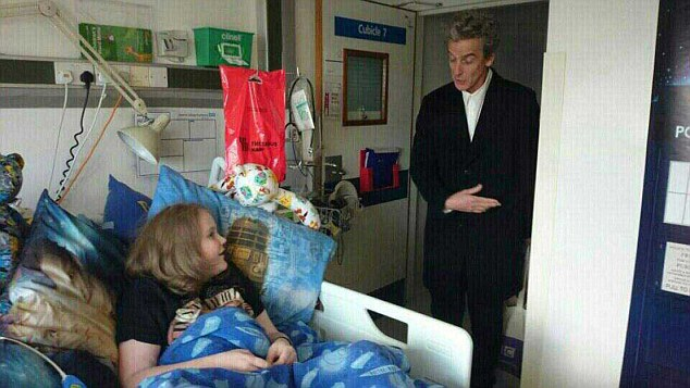Peter Capaldi, right, surprised 14-year-old Daniel Nortan at his hospital bed at St Mary's Hospital, Paddington