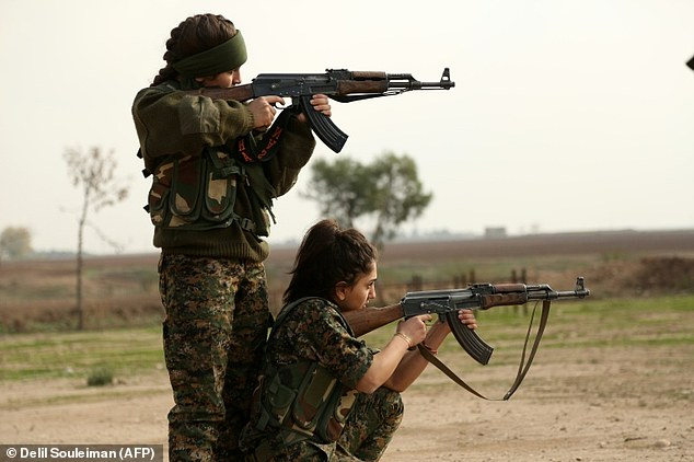 Syriac Christian women, members of the battalion called the 'Female Protection Forces of the Land Between the Two Rivers' train at their camp in the town of al-Qahtaniyah
