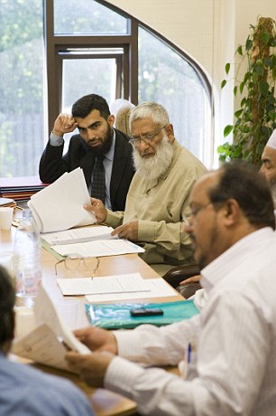 Dr Hasan sits with fellow members at a meeting of the Islamic Sharia Council at Regent's Park mosque