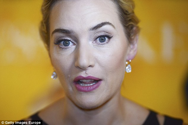 Titanic arch: Oscar-WINNER Kate Winslet, 40, has a very quizzical expression, with one brow extremely arched. However, she insists she is happy to embrace all the changes that age has brought and denies all suggestions of surgery or Botox as '100 per cent not true'