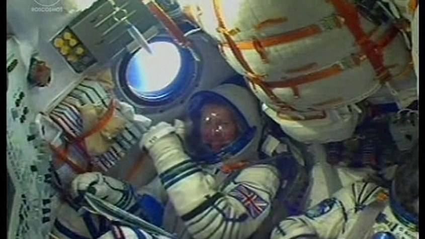Major Peake, a former Army helicopter pilot, is on his way to the ISS in a module the size of a van, which sits on top of a Soviet rocket based on a 1950s ballistic missile. He is pictured inside the capsule giving a 'thumbs up' to the on-board camera