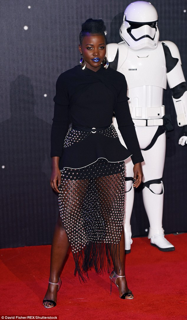 Futuristic fashion: Lupita Nyong'o stole the show at the Star Wars: The Force Awakens film premiere in London's Leicester Square on Wednesday night