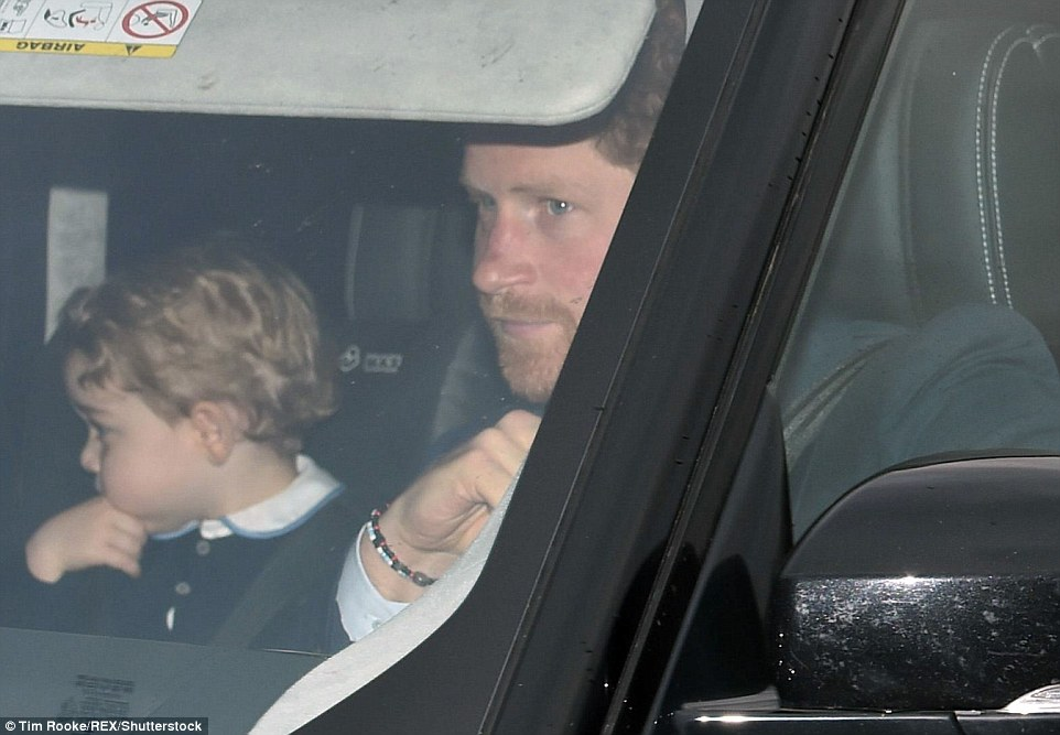 As ever, two-year-old Prince George of Cambridge (left) stole the show when he arrived at the palace for his great grandmother the Queen's annual pre-Christmas lunch yesterday afternoon, with his Uncle Harry in the front