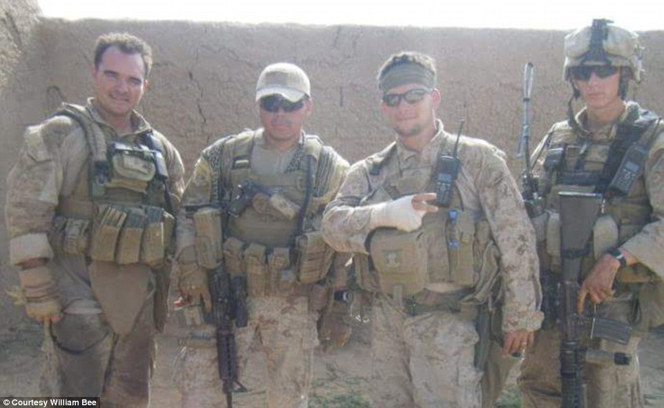 Bee (second from right) stands alongside some of his fellow Marines on one of his tours. A brain injury forced his military career to end, and from then he had to endure rehab and a battery of tests