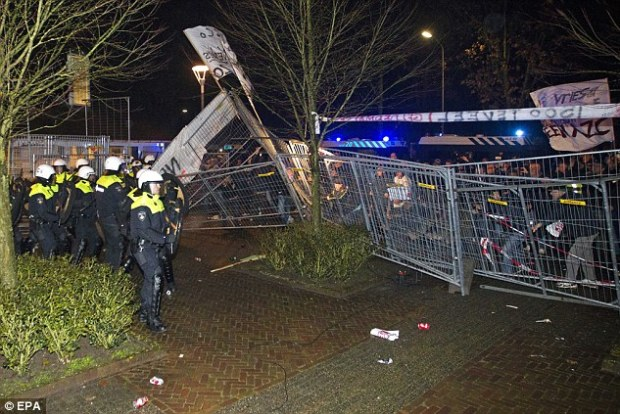 Thousands of rioters smashed the fences around a planned asylum centre in the Dutch townGeldermalsen in the worst riot of its kind