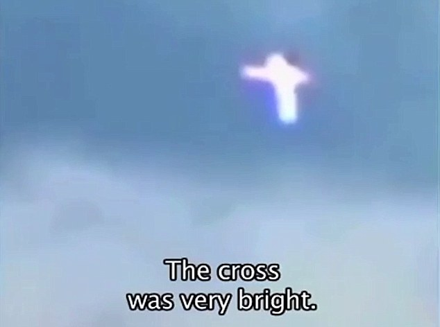 Message from God... or a kite in bad light? Mysterious bright crosses like this one have sparked frenzied speculation among paranormal enthusiasts after they were allegedly filmed flying over Ukrainian war zones