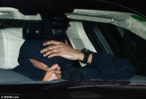 The man pulled his hood down to hide his face, as Mourinho left the club for a second time