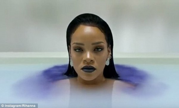 Artistic:Moments later she submerges herself, before re-emerging and suddenly surrounded by purple dye