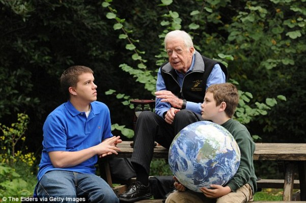 Former president Jimmy Carter's (center) grandson Jeremy (pictured left in 2009) has died unexpectedly at the age of 28. Carter is seen talking to Jeremy and another grandson Hugo Wentzel (right) in Istanbul, Turkey