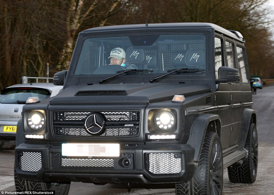Memphis Depay arrives for training on Monday morning in his deluxe four-wheel-drive with personalised C7 headrests
