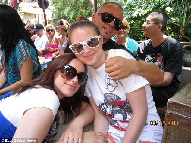 Big happy family: Maria Chernykh with her boyfriend Oscar Romero and her sister Tatiana. Tatiana came to the US in 2006, Mariya arriving three years later