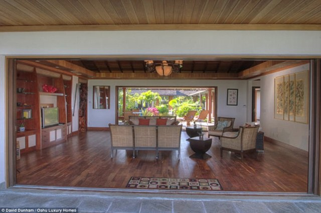 Living room: Obama's eighth consecutive Christmas vacation to Hawaii begins just as a new report published on Thursday showed the total cost of Obama's vacations since taking office in January 2009 has now hit $70.5million. Obama pays out of pocket for this luxury accommodation, however