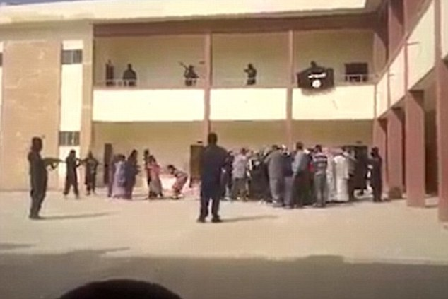 Harrowing: Shocking footage has emerged which appears to show ISIS gunmen dragging terrified wives and daughters from their families to make them sex slaves in an apartment block. A fatwa has been discovered in Syria which contains extremely detailed rulings on when the 'owners' of female slaves can have sex with them