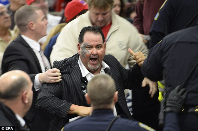 YER OUTTA HERE: Todd 'The Punisher' Poulton, a celebrity boxer, jumped on the protester and wrestled him to the ground