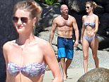 Mandatory Credit: Photo by Christophe Leffondre/SIPA/REX/Shutterstock (5504855b) Jason Statham and Rosie Huntington-Whiteley enjoying a white sand beach at hotel Amanpuri Jason Statham and Rosie Huntington-Whiteley on holiday, Phuket, Thailand - 29 Dec 2015
