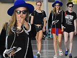 Cara Delevingne and friends Suki Waterhouse and st. Vincent spotted at the airport in BarbadosnnPictured: Cara Delevingne, Suki Waterhouse and St.VincentnRef: SPL1201631  301215  nPicture by: Charlie Pitt/246Paps/Splash NewsnnSplash News and PicturesnLos Angeles: 310-821-2666nNew York: 212-619-2666nLondon: 870-934-2666nphotodesk@splashnews.comn