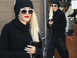 West Hollywood, CA - Singer Gwen Stefani treated herself to a mani at Planet Nails. Stefani looked chic in an all black outfit as she entered the establishment. Known for her distinctive style, Stefani has landed herself in the forefront of fashionistas this year with make up collaborations and her fashion line. The Voice judge has been in the light as of lately due to her recent divorce and her steamy relationship to other judge Blake Shelton who also divorced his wife this past summer to be with the singer. She was spotted wearing a cropped oversized pant, turtleneck sweater, black stiletto boots, and her fresh mani was a french tip perfect for any New Year's look. n  nAKM-GSI     December 30, 2015nTo License These Photos, Please Contact :nSteve Ginsburgn(310) 505-8447n(323) 423-9397nsteve@akmgsi.comnsales@akmgsi.comnornMaria Budan(917) 242-1505nmbuda@akmgsi.comnginsburgspalyinc@gmail.com