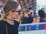 Picture Shows: Gigi Hadid  December 30, 2015n n Model Gigi Hadid was spotted out at lunch with friends in Miami, Florida. Fans recognized her and quickly swarmed around for photos. Gigi seemed happy to pose with them.n n Non Exclusiven UK RIGHTS ONLYn n Pictures by : FameFlynet UK © 2015n Tel : +44 (0)20 3551 5049n Email : info@fameflynet.uk.com